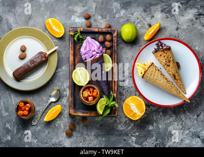 Colorful ice cream cones of different flavors.Mix of colorful tasty popsicles - Stock Photo