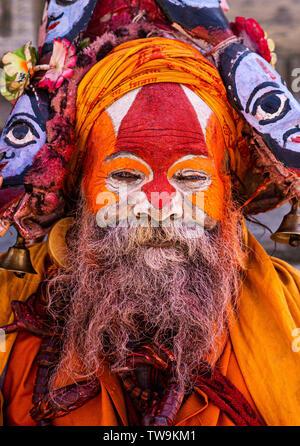Sadhu or holy man at Pashupatinath temple complex in Kathmandu, Nepal.  Sadhus renounce worldly life to follow path of spiritual discipline - Stock Photo