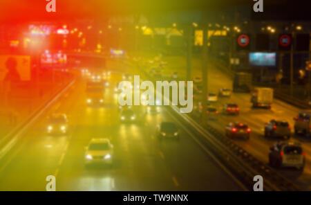 Blurred background. Night city lights blur. Retro toned photo, vintage. - Stock Photo