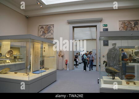 Visitors enter a room with historical artefacts from the Roman Empire on display in the British Museum in London, United Kingdom. - Stock Photo