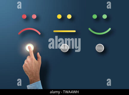 customer service rating and survey concept with dissatisfied customer touching interface button with sad face - Stock Photo