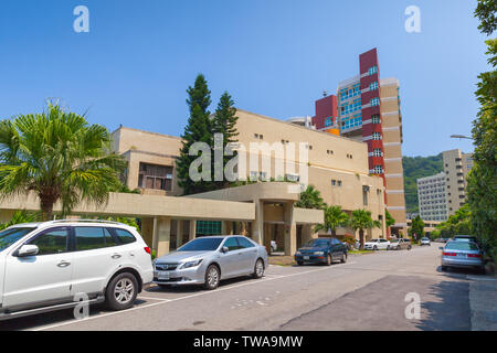 Keelung, Taiwan - September 5, 2018: Street view with cars parked near buildings of the National Taiwan Ocean University at sunny day - Stock Photo