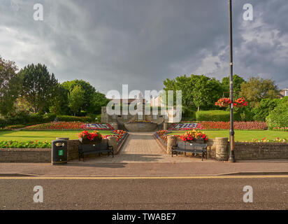 The First World War Memorial at Carnoustie, off the High Street on a warm July evening seen in the golden light of a setting sun. Carnoustie, Scotland - Stock Photo