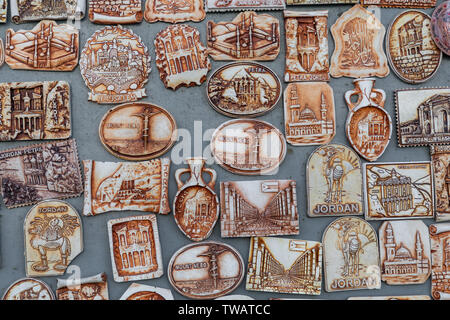 Many magnets on the refrigerator from Jordan. - Stock Photo