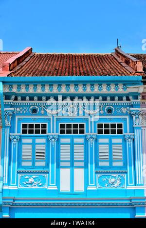 Front view of colourful traditional Singapore Peranakan or Straits Chinese shophouse in historic Joo Chiat East Coast Singapore - Stock Photo