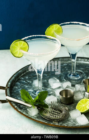 classic margarita cocktail on the table with bar accessories. - Stock Photo