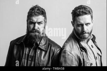 Men brutal bearded hipster. Handsome stylish and cool. Masculine and brutal friends. Bully team. Masculinity and brutality. Feel confident in brutal leather clothes. Brutal men wear leather jackets. - Stock Photo