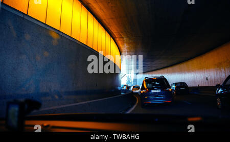 Paris, France - May 14, 2014: Driver POV point of view personal perspective at the traffic jam front driving Ford French cars inside the tunnels of Paris Peripherique ring road - Stock Photo