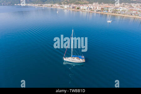 Sailboat at anchorage near the town of Marmaris in Turkey. Aerial top view. - Stock Photo