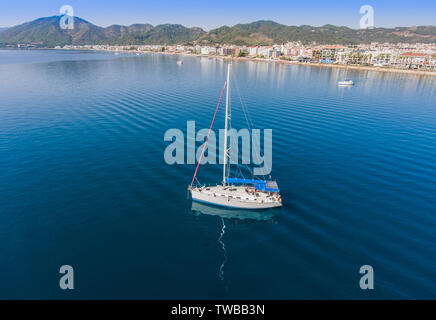 Sailing yacht at anchorage near the town of Marmaris in Turkey. Aerial top view. - Stock Photo