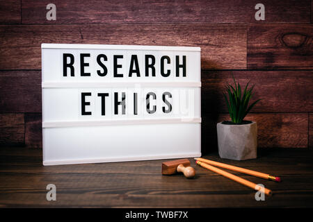 Research Ethics. Text in lightbox - Stock Photo