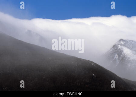 Tuckerman Ravine, on the eastern slope of Mount Washington, in the New Hampshire White Mountains during an extremely windy winter day. Lion Head is on - Stock Photo