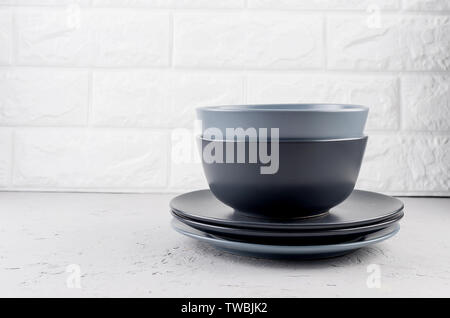 Set of clean Ceramic crockery tableware on gray concrete background, color bowls, plate, cup, dishes.  tableware set concept - Stock Photo