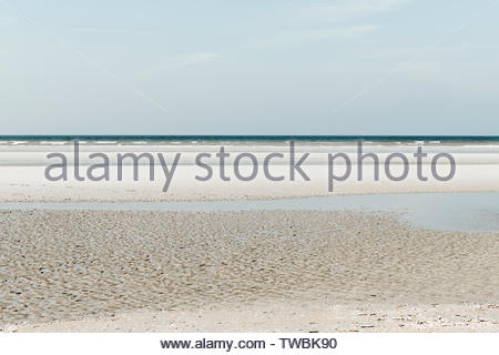 Oostduinkerke, Belgium - Minimalistic seascape with layers and green tint - Stock Photo