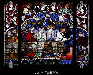 A stained glass window depicting The Wedding in Cana. Jesus turns water into wine, Strasbourg Cathedral of Notre Dame - Stock Photo