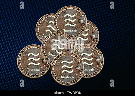 Valencia, Spain - June 18, 2019: Group of 1 Libra coins, new cryptocurrency launched by Facebook to compete with bitcoin, digital composition. - Stock Photo