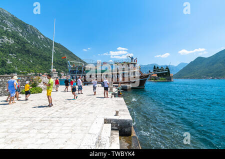 Perast, Montenegro - June 10. 2019: Tourists on an artificial island of Gospa od Skrpjela. - Stock Photo