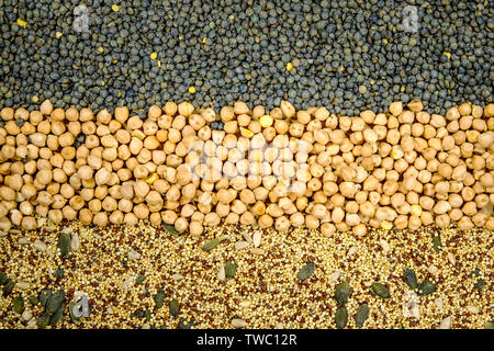 Selection of Mixed Healthy Seeds and Pulses Green Lentils Chickpeas Chia Pumpkin and Sunflower Seeds for Vegetarian and Vegan Diets - Stock Photo