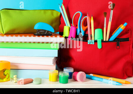 School supplies on wooden table against color background, closeup - Stock Photo