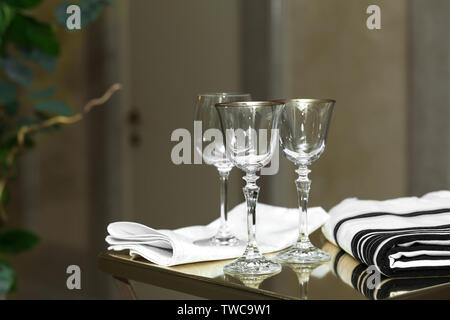 Empty glasses and glasses with a gold border stand on the wedding ceremony. Jewish and Jewish traditions. - Stock Photo