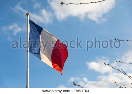 French flag waving on the wind - Stock Photo