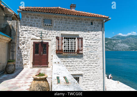 Perast, Montenegro - June 10. 2019: Fragment of a Church of Our Lady of the Rocks on Skrpjela - Stock Photo