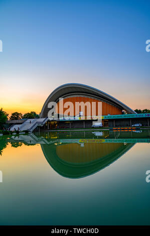 Berlin, Germany - June 17, 2019: House of World Cultures in downtown Berlin in the sunset. The yellow sign means Watermusic in German, on the neon sig - Stock Photo