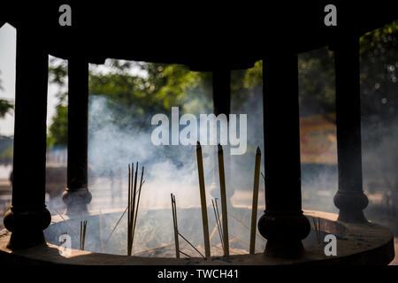 Incense burning at Po Lin Monastery. Hong Kong - Stock Photo