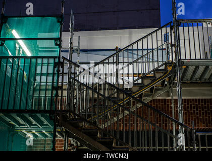 building site scaffold stairway and builders mesh - Stock Photo