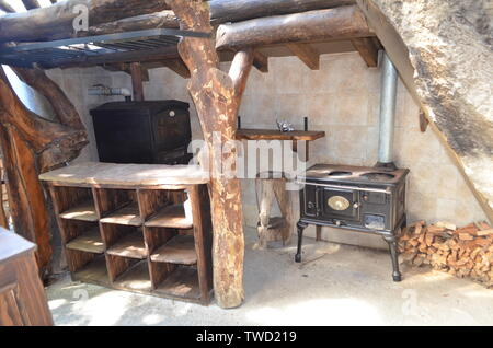 Bariloche, Argentina.Detail view of old kitchen with firewood. - Stock Photo