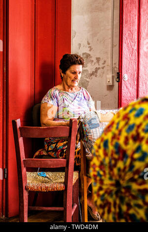 Artisan woman doing bobbin lace work in Sambaqui, at Santo Antonio de Lisboa district. Florianopolis, Santa Catarina, Brazil. - Stock Photo