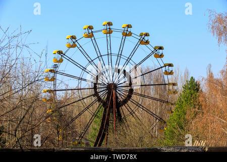 Eastern Europe, Ukraine, Pripyat, Chernobyl. Ferris wheel in amusement park. - Stock Photo
