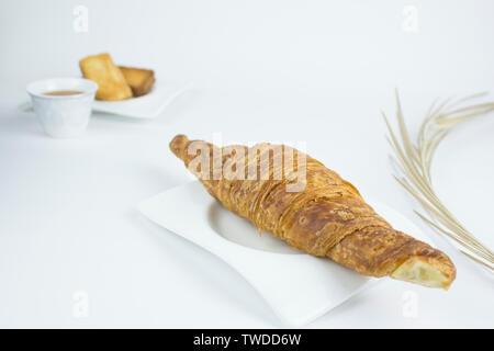 Tea time croissant break - Stock Photo