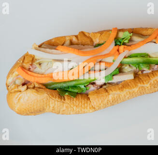 A close-up of a traditional Banh Mi Sandwich. Banh Mi Sandwiches came from the influence of the French colonization in the mid 19th century. - Stock Photo