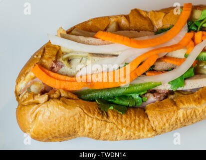 Close up shot of a traditional Banh Mi Sandwich. Banh Mi Sandwiches came from the influence of the French colonization in the mid 19th century. - Stock Photo