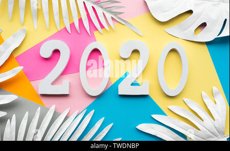 2020 new year celebration concepts presents text number decoration with tropical leaf on  colorful background.Inspiration ideas design.Goal plan and a - Stock Photo