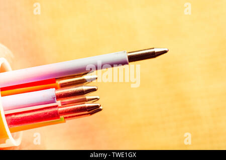 Multi colored pen on a textured background on display - Stock Photo