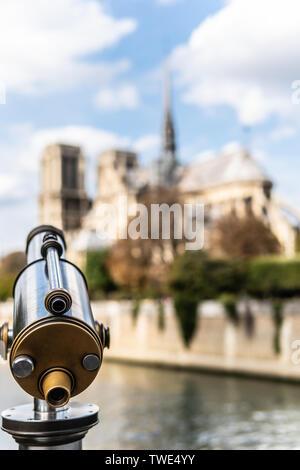 Paris, France, October 11, 2018: public pay-per-view observational telescope, Notre Dame cathedral, Notre-Dame de Paris is French Gothic architecture - Stock Photo