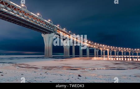 Western high speed diameter on Kanonersky Island in Saint Petersburg in the winter in the evening - Stock Photo