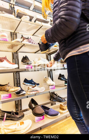 buying shoes, choosing shoes, shoe shopping, Skechers shoe shop, Skechers shoes, Skechers, Skechers shoe store, interior, inside, shoes, display, - Stock Photo