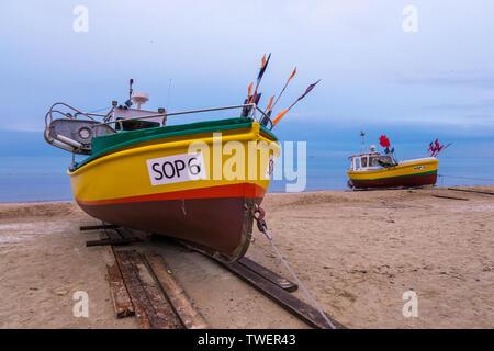 Sopot, Poland - February 06, 2019: Fishing boats on the sandy beach at the Baltic Sea coast in Sopot, Poland - Stock Photo