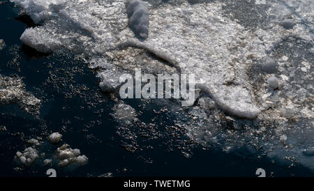 Ice floes on the sea surface. - Stock Photo