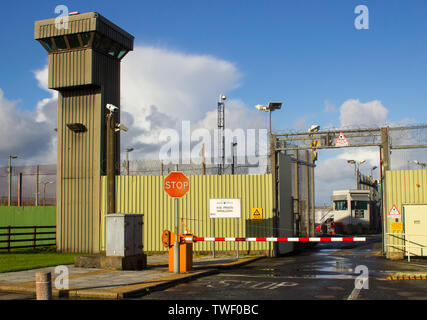 The high observation towers and security fencing at the entrance to the Magilligan Prison in County Londonderry on the North Coast of Ireland - Stock Photo
