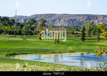 Scene of a beautiful park in Logrono Spain with a lake and hills - Stock Photo