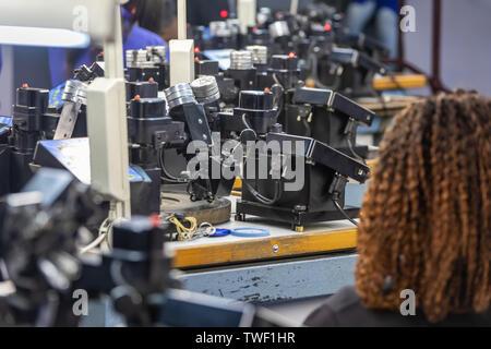 Machines to polish diamonds, grading diamonds, african woman working. In Africa , Botswana - Stock Photo