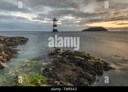 Penmon point lighthouse sunrise in Anglesey. - Stock Photo