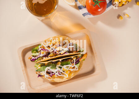 Traditional mexican taco with meat and vegetables. Latin american food. - Stock Photo