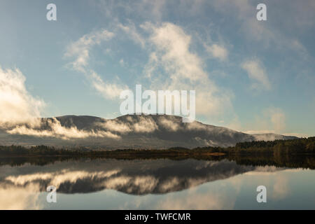 Rising mist on Loch Garten in the Cairngorms National Park of Scotland. - Stock Photo