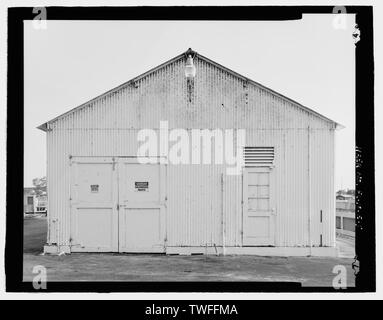PLANAR VIEW OF EAST SIDE OF WAREHOUSE, VIEW TOWARDS WEST - Moore Haven Lock, Warehouse, Cross-State Canal, Okeechobee Intracoastal Waterway, Moore Haven, Glades County, FL - Stock Photo