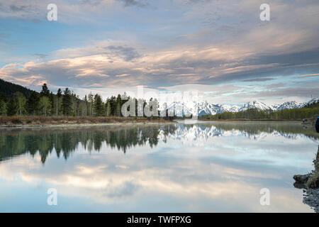 Sunrise over Mount Moran, Snake river in the foreground - Stock Photo